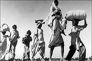 180px-old-sikh-man-carrying-wife19472